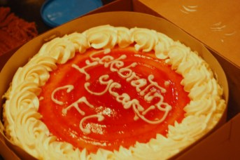 "Picture of Round Cake with Icing that says ""Celebrating 1 year CFC"""