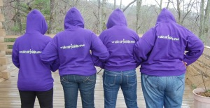 Four CFs showing off the CFC Sweatshirt logo